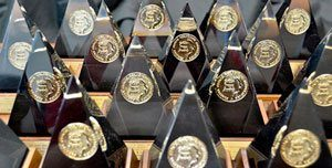 Pyramidal-shaped awards of recognition.
